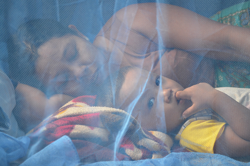 Mother and child under net, Kyun Su township, Sept 2013 (source Malaria Consortium)