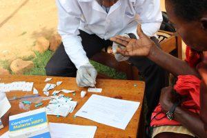 Malaria testing in the community using an RDT, Masaka, Uganda