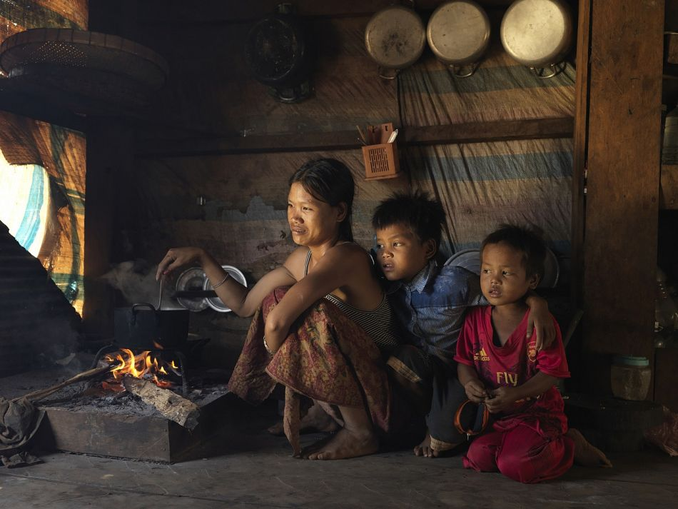 pResidents of Kakthom village cooked at their house with a typical charcoal and wood stove Inhouse smoke is a risk factor for pneumonia for children under five years oldbr br Copyright Malaria ConsortiumPeter Catonp