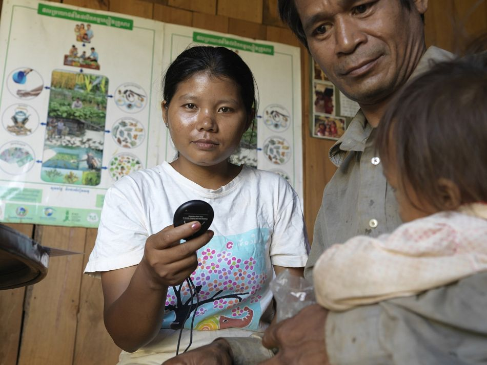 pRomas Dean is a village malaria worker in Ratanakiri Province who took part in the training After returning to her village she continues to diagnose and treat malaria diarrhoea and pneumonia in her rural community Here she used a respiratory rate timer to assess symptoms of a young child who had come to seek treatment at her housebr br Copyright Malaria ConsortiumPeter Catonp