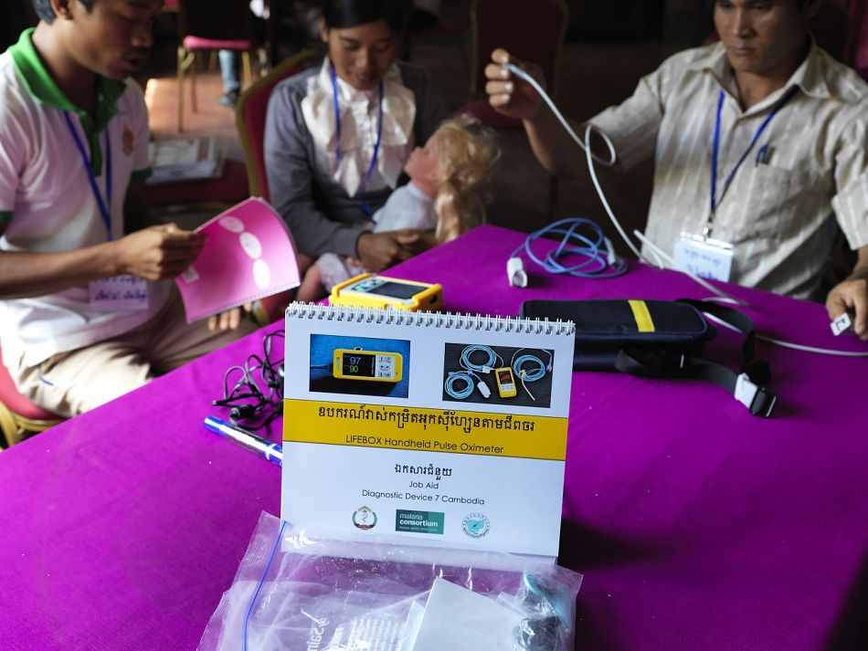 pThe first step of the project involved device selection where the most promising existing devices for pneumonia diagnosis were identified for field testing Here a LIFEBOX Handheld Pulse Oximeter is on display ndash a device that measures oxygen levels in the blood to diagnose pneumoniabr br Copyright Malaria ConsortiumPeter Catonp
