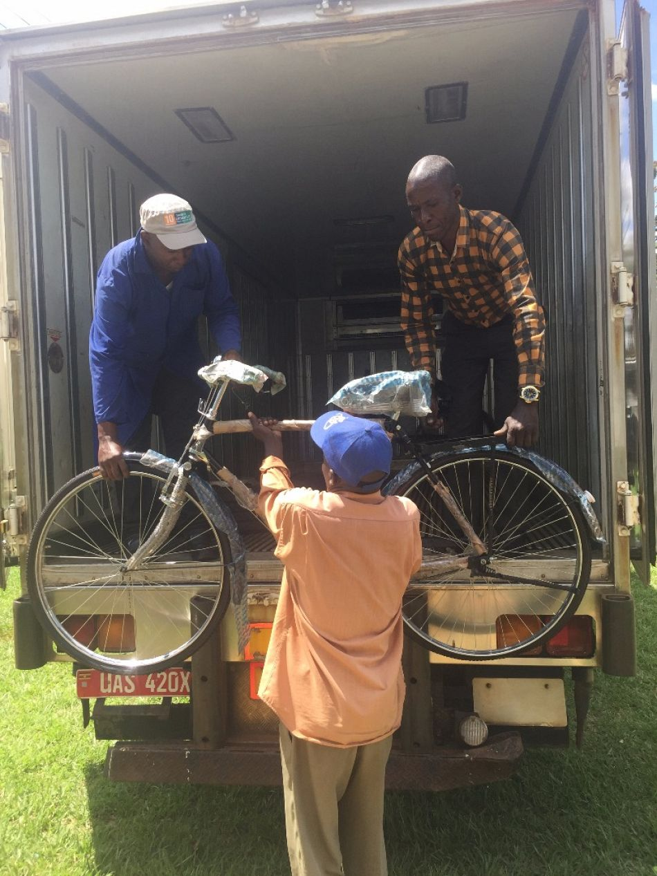 pThe last bicycle is unloaded in Iyolwa as the members of villages health teams begin to arrive to collect their new bicyclep