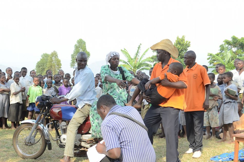 pDrama groups provide another innovative platform to spread health messages among communities In this photo a community in Mbale Uganda watches a performance that shows what to do when someone falls sick from malariap