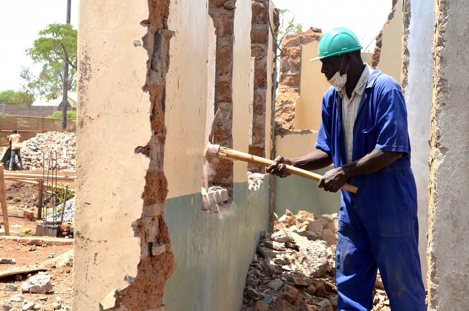 pMoses Owori Foreman helps to knock down the walls of the clinicnbspp