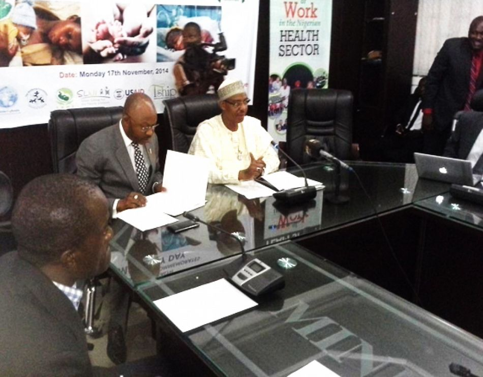 pThe Hon Minster FMOH Dr Khaliru Alhassan in native dress and thenbsp Permanent Secretary FMOH Mr Linus Awute at the press briefing on World Pneumonia and Prematurity Day In Nigeria Nov 18 2014p