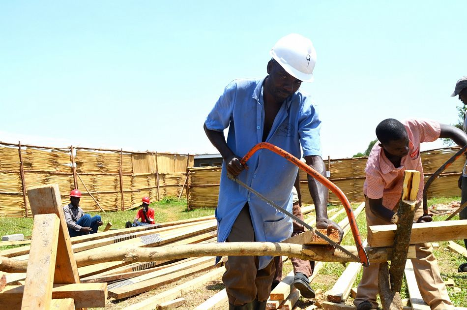 pOkongo Yokim Head Carpenter works with his team in the early stages of the renovationp