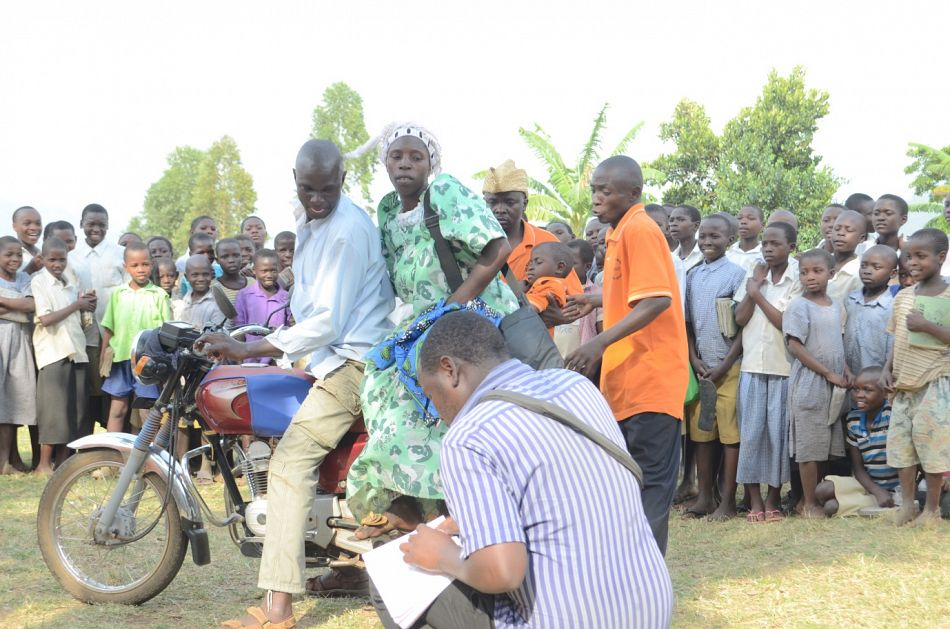 pMugoya shows how to pay for a boda boda driver by completing a payment coupon to be cashed in at the hospitalnbspp