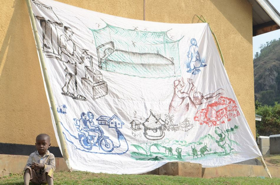 pThe communities create murals and paintings demonstrating what they have learnt This is a painting that was on display in the village demonstrating mosquito net use keeping stagnant water away from the village and showing the benefits of the boda boda hospital referral systemp