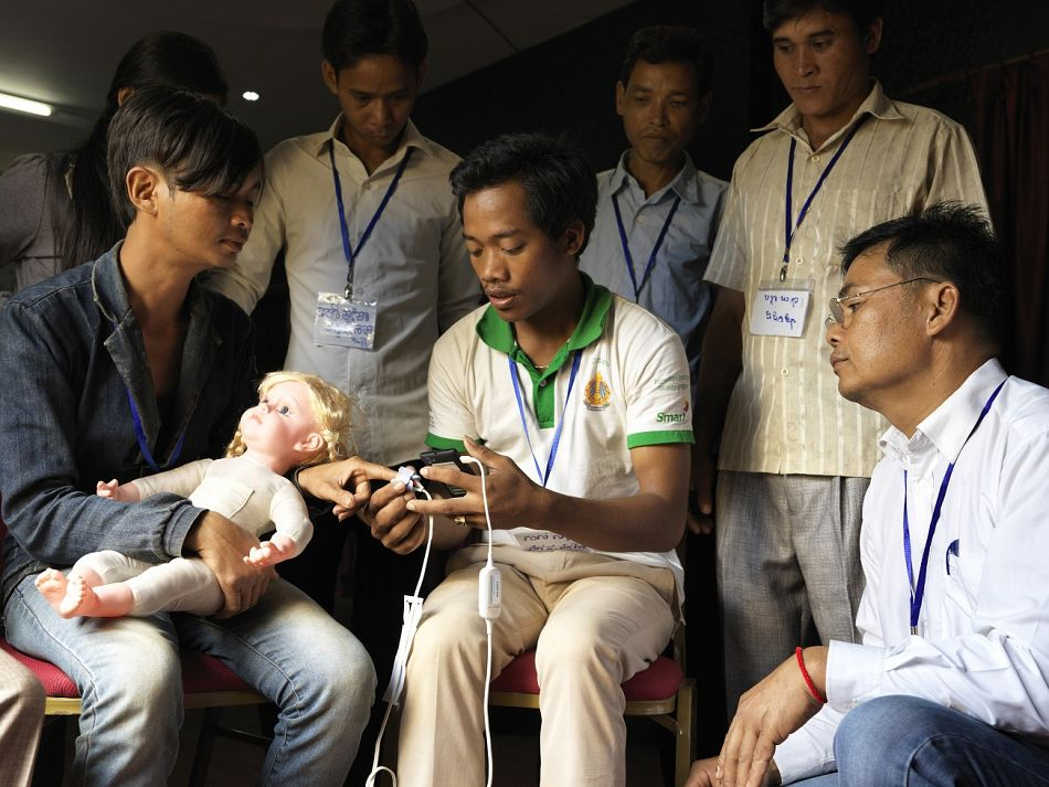 pThe health workers practiced using the devices by testing each other and by conducting role plays with a lifesize dollbr br Copyright Malaria ConsortiumPeter Catonp