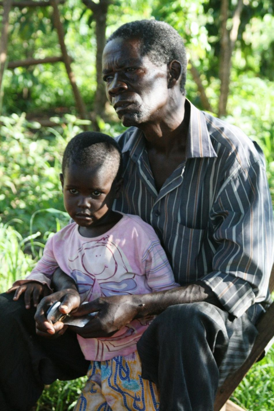 pOne key intervention for managing severe malaria is through rectal artesunate ndash a treatment that can slow down the diseasersquos progression in severe cases This must be followed by comprehensive case management at a health facility and a full dose of antimalarial medicineppHere a father sits with his son whose life was saved when the village health team provided rectal artesunate to buy enough time for him to get to the health centreppCopyright Malaria Consortiump