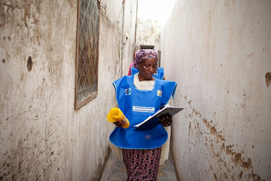 pTo improve uptake of long lasting insecticidal nets we work with campaign volunteers and mobilisers who conduct housetohouse visits to inform community members of distribution campaigns and benefits of nets as well as to distribute net cards for women to bring to distribution points for collection Here a mobiliser in Nigeria walks between households to inform residents of the campaign and its benefitsppCopyright Malaria ConsortiumWilliam Danielsp