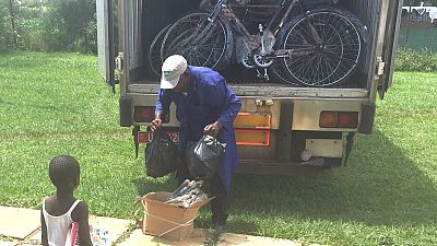 Bicycle repair tool kits and air pumps are the first items to be unloaded.