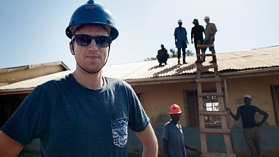 BBC Radio 1 Presenter Greg James on site during the renovation. Copyright Will Boase/Comic Relief