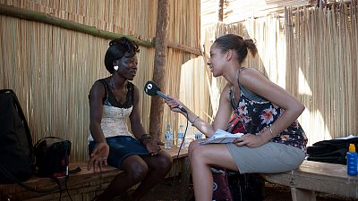 BBC Radio 1XTRA presenter Yasmin Evans interviews Florence, an electrician working on the renovation of the health centre. Copyright Will Boase/Comic Relief