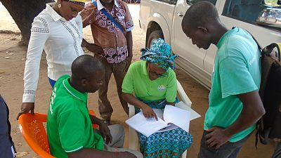 Malaria Consortium supports the provincial and district health authorities to provide regular supervision and support visits to these newly trained volunteers, to ensure they can apply their knowledge and help their communities' better deal with NTDs. Malaria Consortium's Project Manager, Junica Alface, can be seen here showing a community facilitator where he can locate in his guidebook guidance on planning community dialogues. Mogovolas district, Nacoze Community, May 2018.