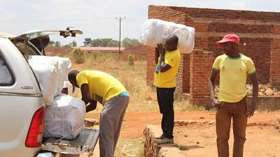 District health staff load vehicles to move LLINs to community distribution centres in the peripheral areas of Lichinga