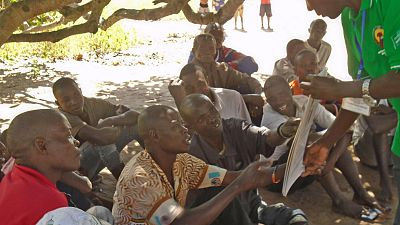 Erati district, Canaruma community: the community dialogue facilitator talks to participants about the images showing signs of intestinal worm infection. Community dialogues provide a community-owned platform to bring basic information closer to people's homes and correct misconceptions about the diseases, their transmission route and control mechanisms.