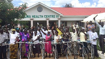 Village health team members from 43 communities receive a bicycle.
