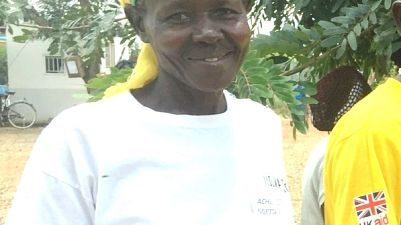 """Achieng Ezeres, village health team member at Ngetta A village, is ready to cycle home: """"I am so grateful for the new bicycle, I am going to look after it very well because it makes our lives as village health team members much, much easier."""""""