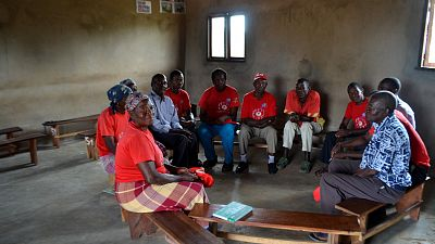 A health committee in Inharrime, Mozambique, meets to discuss health problems facing the community. Malaria Consortium's Rapid Access Expansion (RAcE) project began working with these health committees in order to get communities talking about health through an approach called community dialogues. The project provides training and materials to help committees organise and carry out these dialogues.