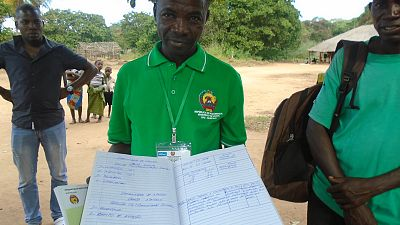 Community-based facilitators keep a log of all dialogues held, topics covered, actions decided and issues raised in a registry book so that they have this information always available to report to their community leadership. This is community dialogue facilitator Charama dos Reis in Mogovolas District.