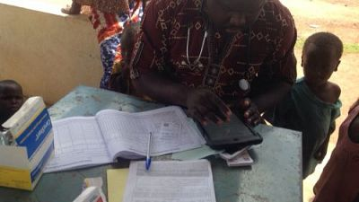 A Community Health Worker documents key data