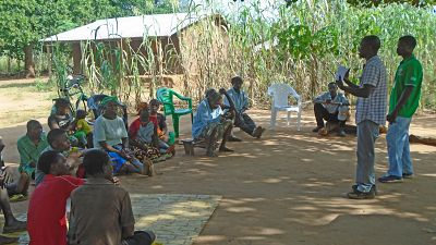 When they returned from training, facilitators met with their community leaders to start planning the community dialogues. All of them started enthusiastically: an average of two dialogues per month were held. They focused the dialogues on lymphatic filariasis and intestinal worms, to try and raise demand and participation in June's mass treatment campaign. A facilitator from Erati district can be seen here engaged in a Q&A session with community dialogue participants.