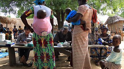 Mothers arrive at an SMC fixed point distribution in Fada, Burkina Faso where there children will receive the lifesaving preventive malaria treatment.