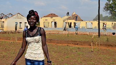 Akello Florence is an electrician working on the renovation of Iyolwa Health Centre III.