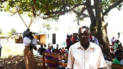 Villager Amosi Obonuyo Otindi outside the temporary clinic.