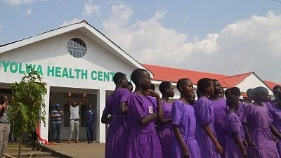 Localschoolchildren performed a dance to celebrate the opening of the new health centre.
