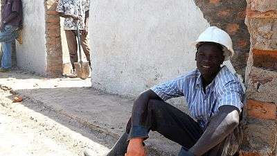 Katand John, one of the builders, takes a short break.