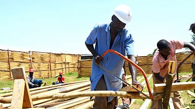 Okongo Yokim, Head Carpenter, works with his team in the early stages of the renovation.