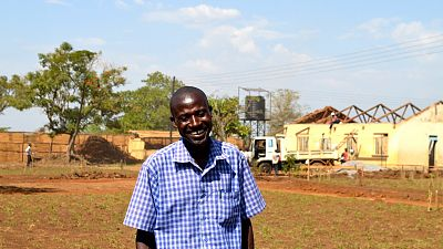 Owere Cosmas acts as a link between local communities and health centres.